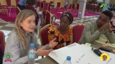 Finland Delegates and Tanzanian Youth Discussing Human Centered Design Approach